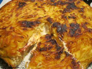 Torta di spaghetti con ricotta, mozzarella e rape